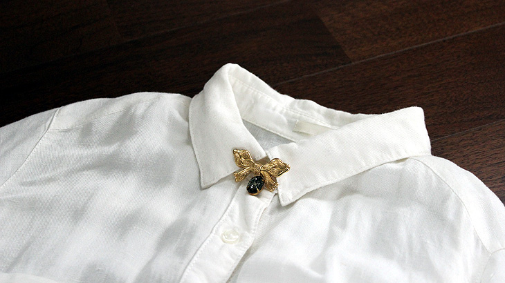 image-of-attaching-a-brooch-to-a-shirt