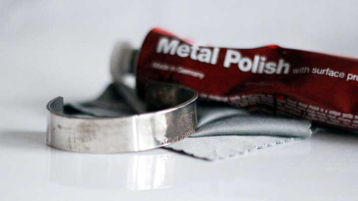 Photo of silver accessories cleaned with metal abrasive